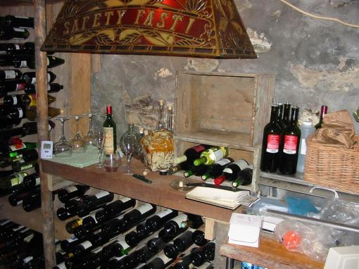 Tasting station with record-keeping logbook and obligatory bottle of ancient Petrus.